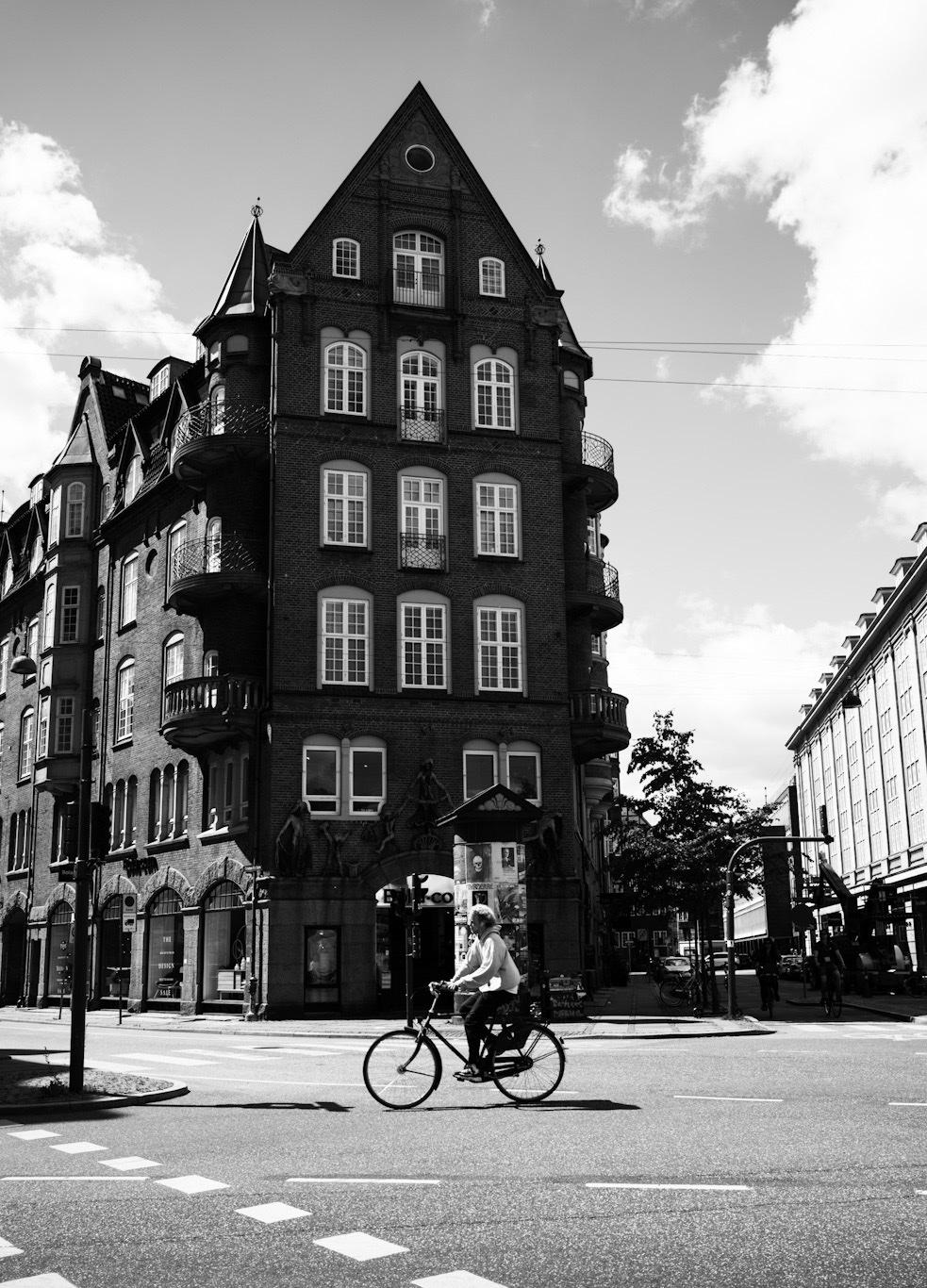 Woman biking in Copenhagen