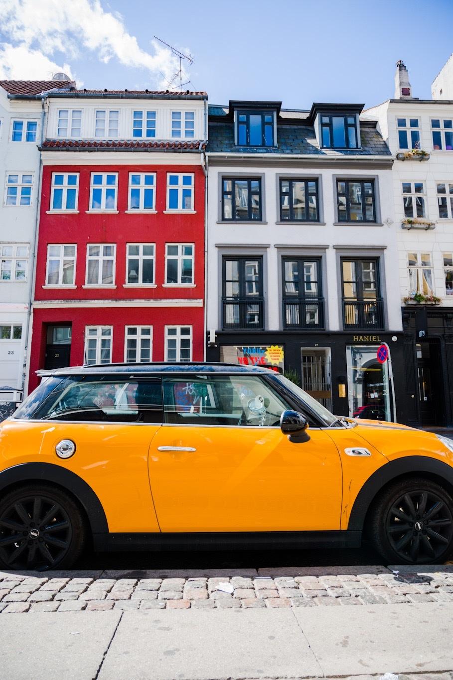 Yellow mini-cooper in historic Copenhagen